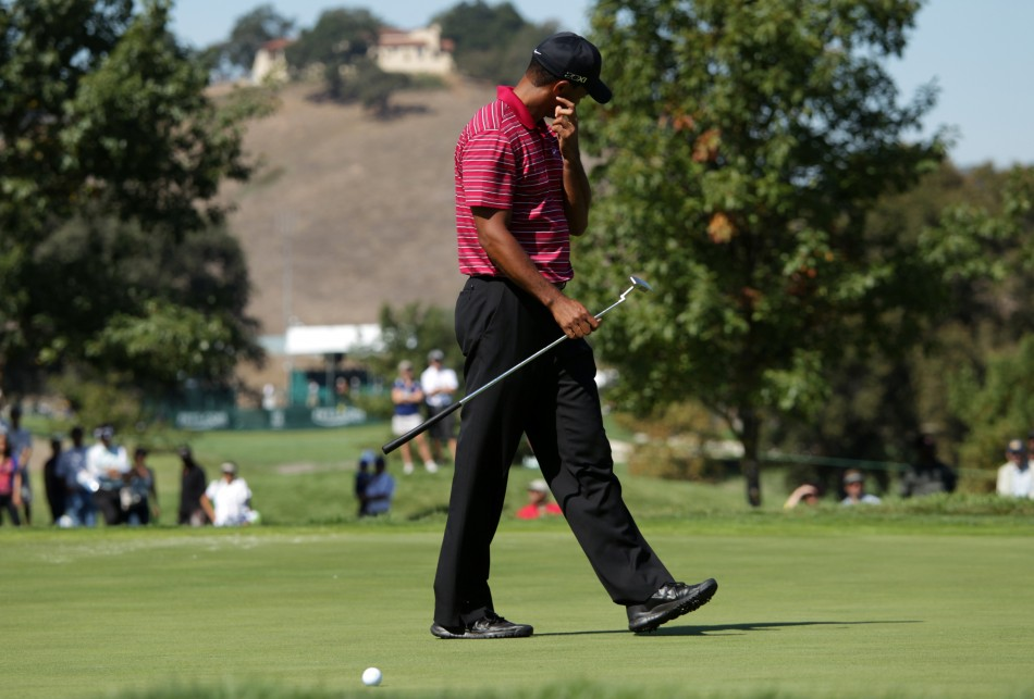 Tiger Woods reacts after missing a birdie putt at the third hole during the final round of a PGA Tour golf tournament in San Martin