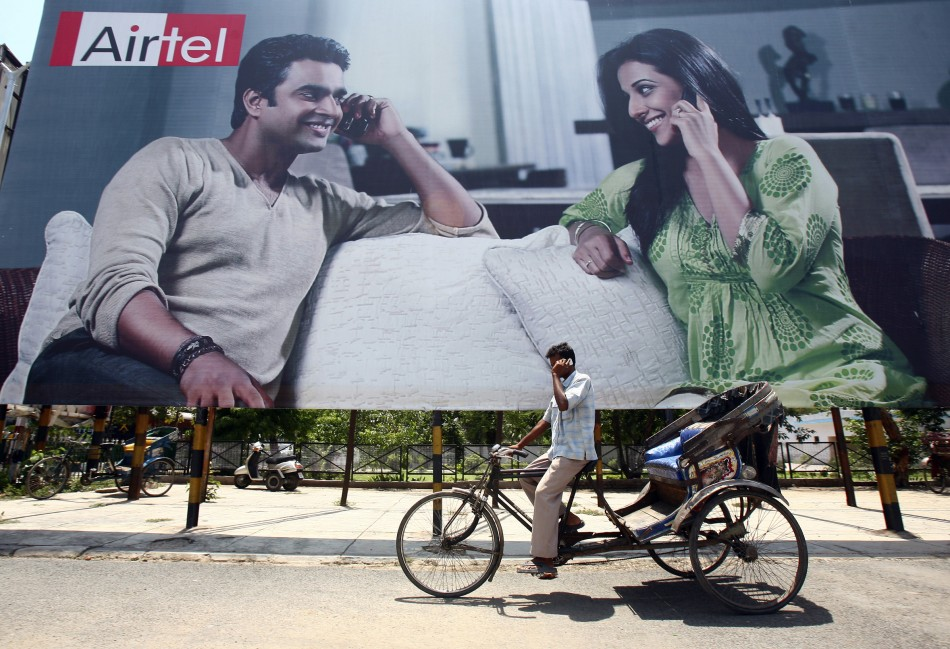 Rickshaw driver talks on his mobile phone in Chandigarh