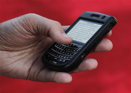 A Blackberry Tour device is shown in use in Hollywood