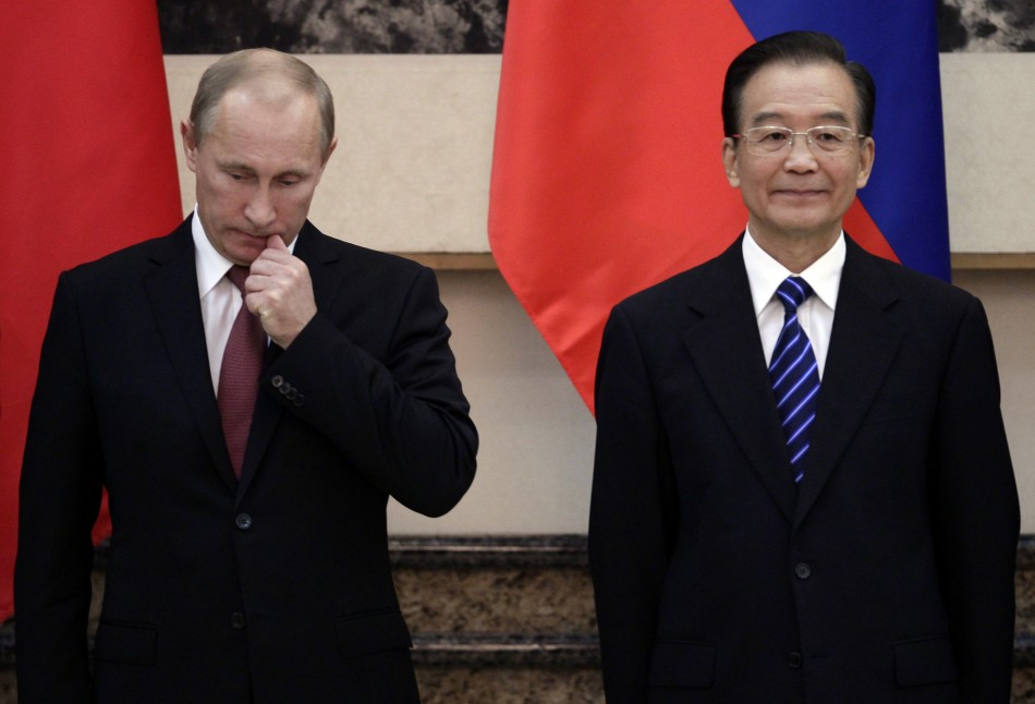 Russia's Prime Minister Vladimir Putin reacts as he and China's Premier Wen Jiabao attend a signing ceremony in Beijing