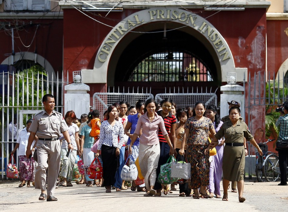 Released prisoners make their way out of Insein Prison in Yangon