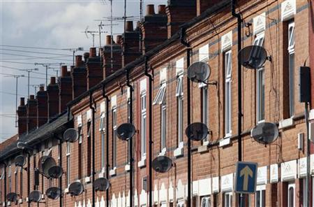 Satellite television dishes are seen fixed to a row of terraced houses in Leicester