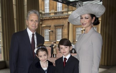 Welsh actress Catherine Zeta-Jones and her husband U.S. actor Michael Douglas, pose with their children