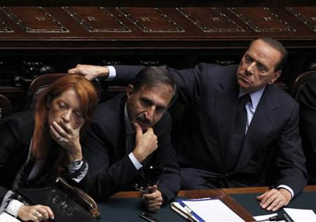 Italy's Prime Minister Berlusconi attends near Italy's Tourism Minister Brambilla and Defence Minister La Russa during a debate at the lower house of parliament in Rome