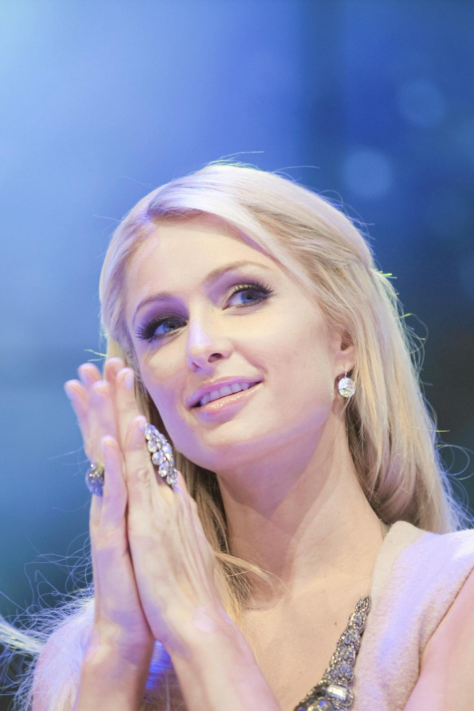 Paris Hilton smiles as she attends an opening ceremony of a shopping center in Katowice.