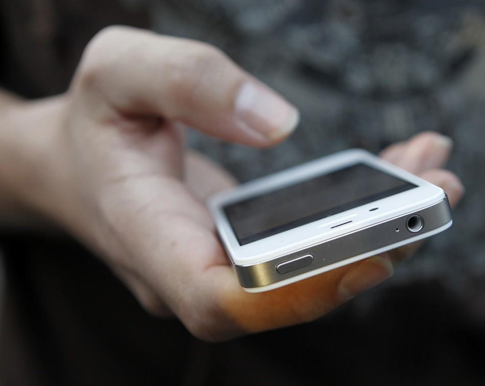 Holding iPhone
