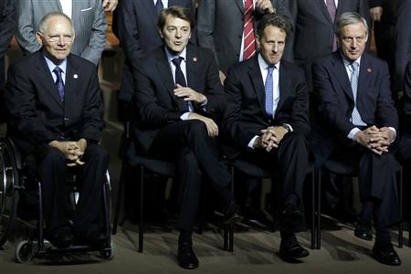 The German Finance Minister Wolfgang Schauble, France's Finance Minister Francois Baroin, the U.S. Treasury Secretary Tim Geithner and France's Central Bank Governor Christian Noyer pose together during the G20 meeting in Paris.