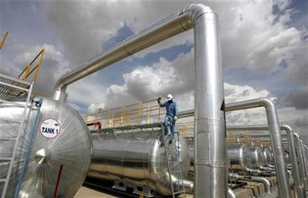 A Cairn India employee works at a storage facility for crude oil at Mangala oil field at Barmer in the desert Indian state of Rajasthan