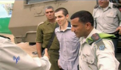 Gilad Shalit is greeted by Israeli army officers at Kerem Shalom