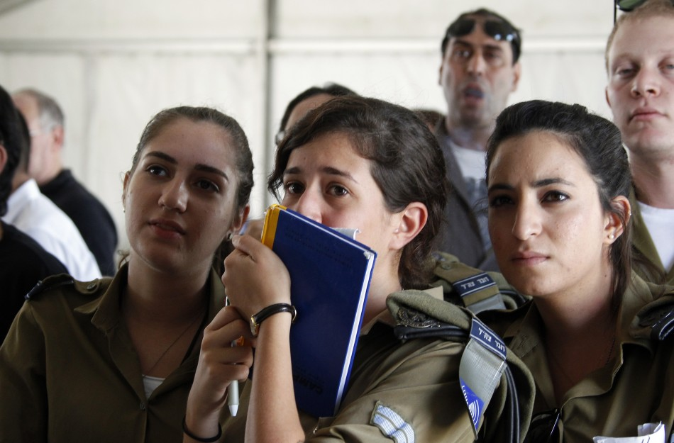 Soldiers from the Israeli army Spokespersons Unit react at Tel Nof air base in central Israel