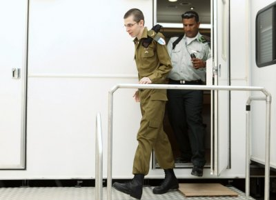 Gilad Shalit walks at Kerem Shalom crossing