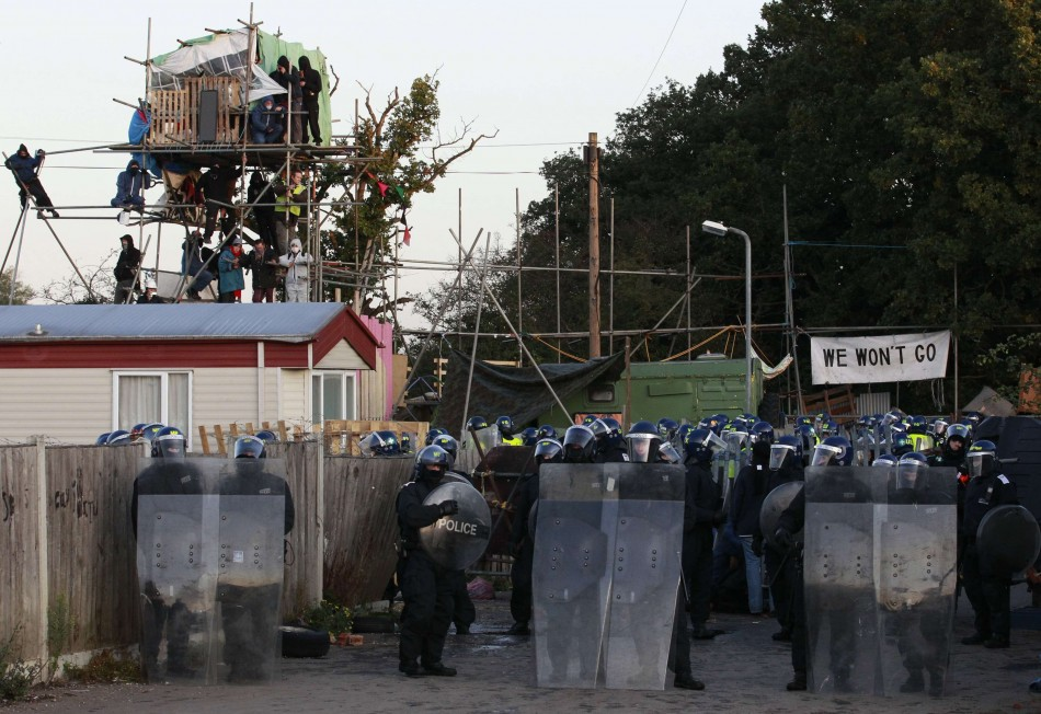 Police in riot gear prepare to move onto the Dale Farm Traveller site