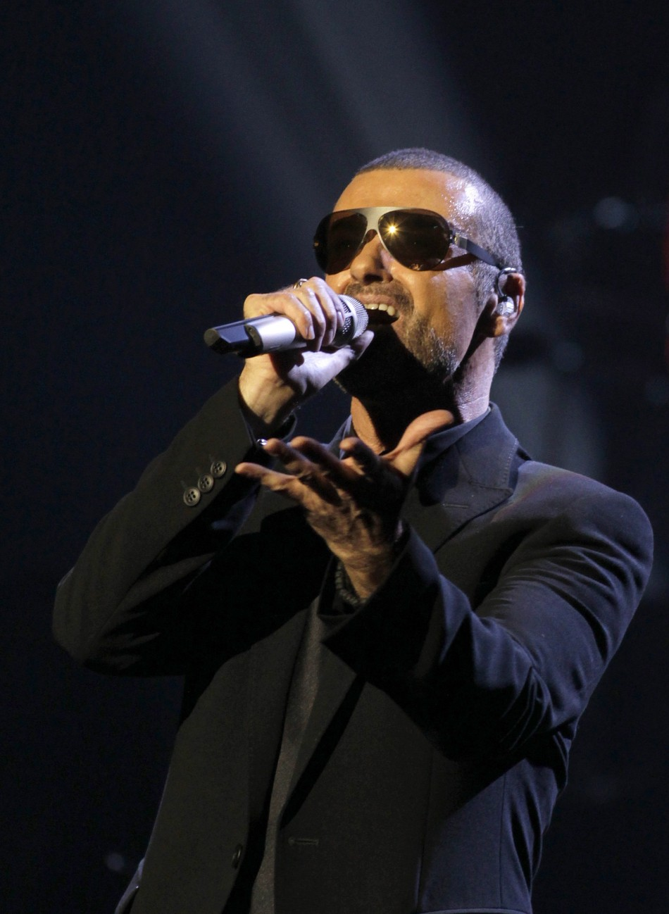 British singer George Michael arrives on stage before his concert in Prague