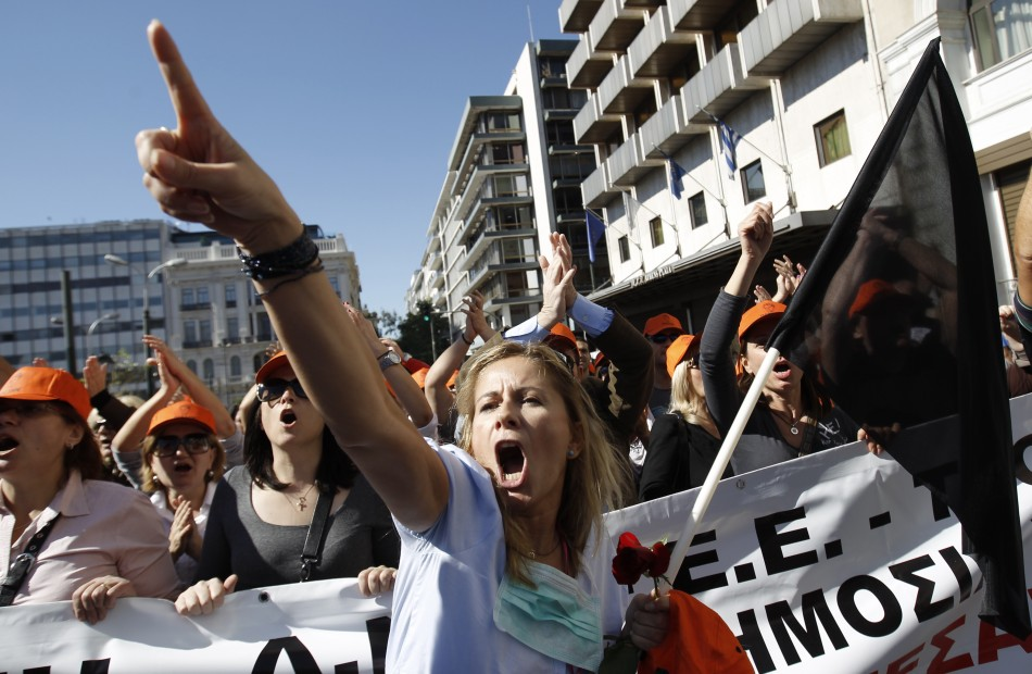 A woman shouts while taking part in an anti-austerity rally in Athens' Syntagma square