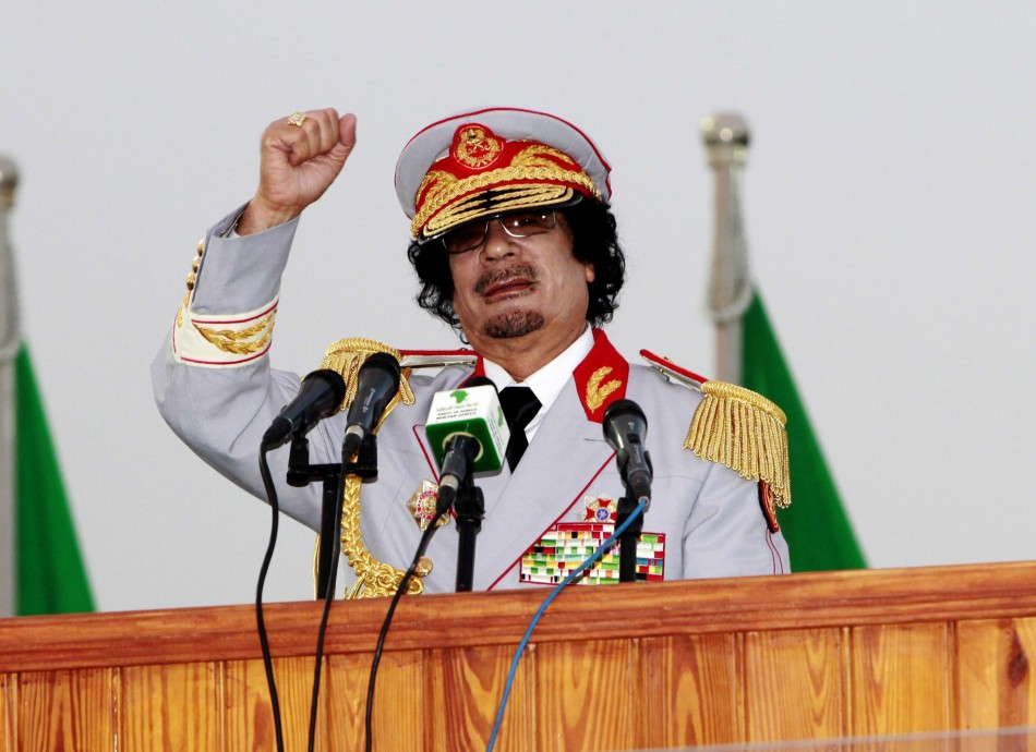 Libyan leader Moammar Gadhafi speaks during a ceremony to mark the 40th anniversary of the evacuation of the American military bases in the country, in Tripoli