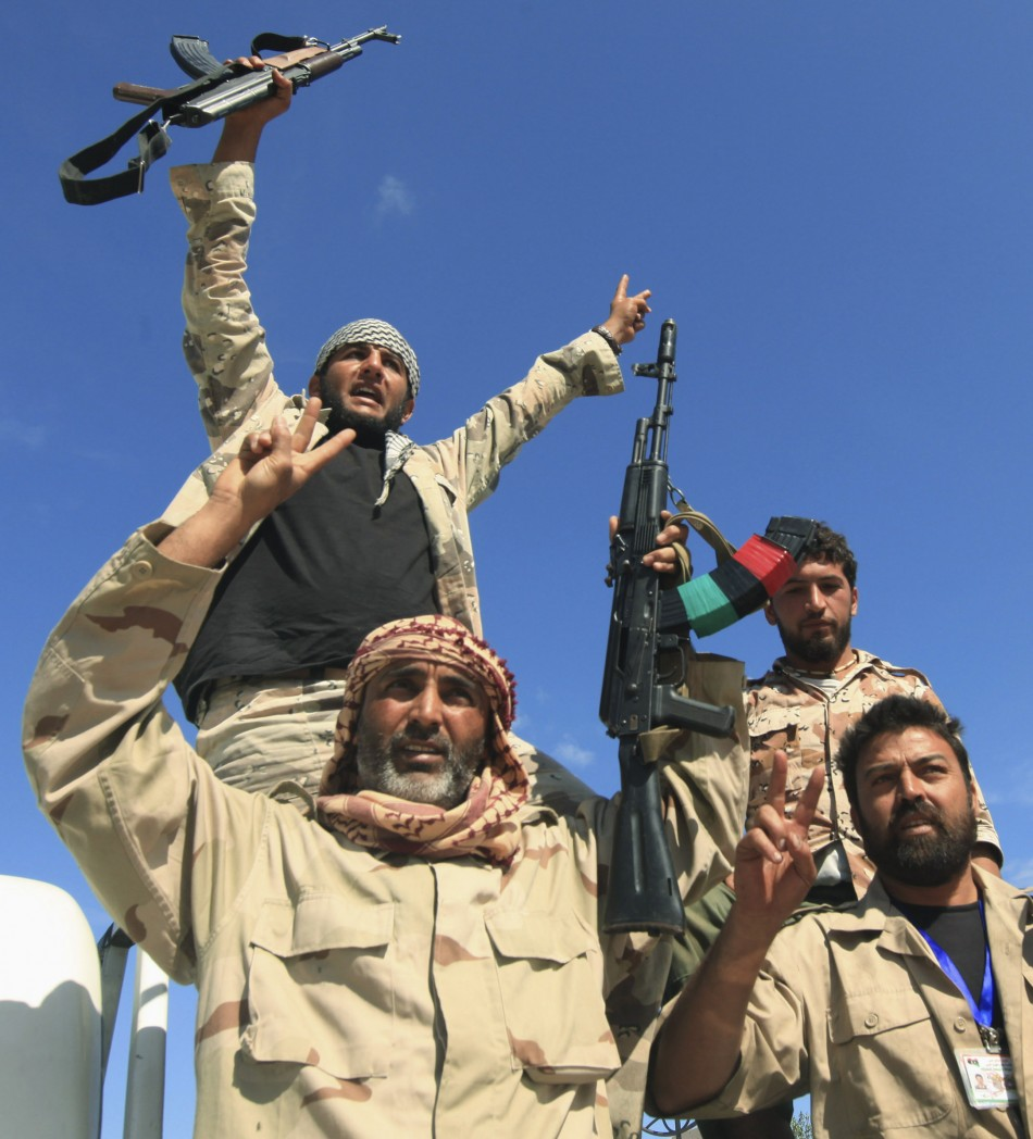 Anti-Gaddafi fighters celebrated the fall of Sirte
