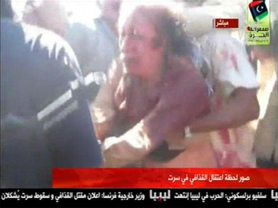 Moammar Gadhafi Minutes Before he Was Dragged and Killed.