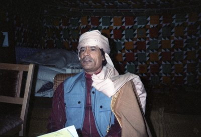 Moammar Gadhafi, inside his Bedouin tent 1986 where he presented his family to U.S. women journalists during a news conference.