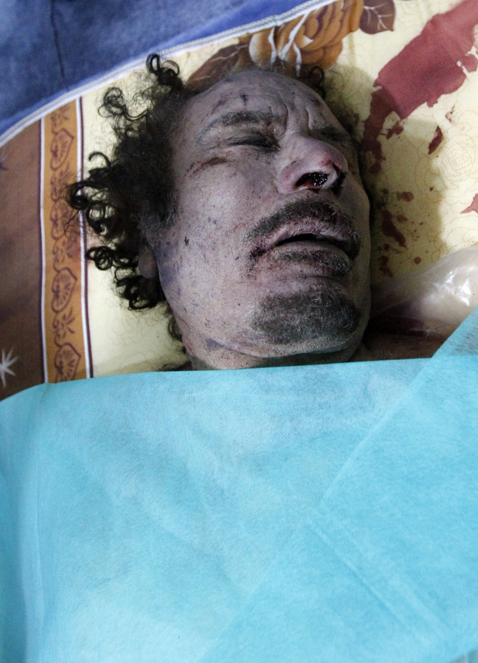 Muammar Gaddafi Killed: Dead Body Photos Released