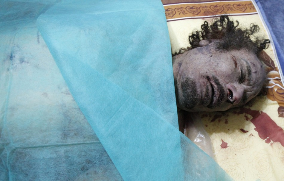 The body of Muammar Gaddafi is seen at a house in Misrata