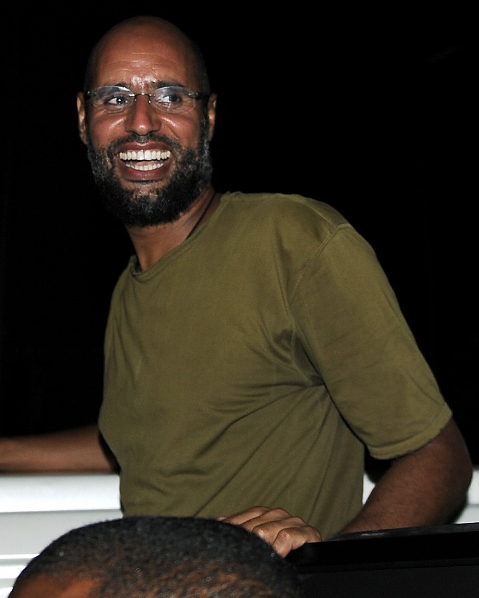 Saif al-Islam, the son of Libyan leader Muammar Gaddafi, smiles as he greets supporters in Tripoli