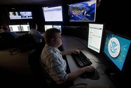 Analysts work in a watch and warning center of a cyber security defense lab at the Idaho National Laboratory in Idaho Falls, Idaho