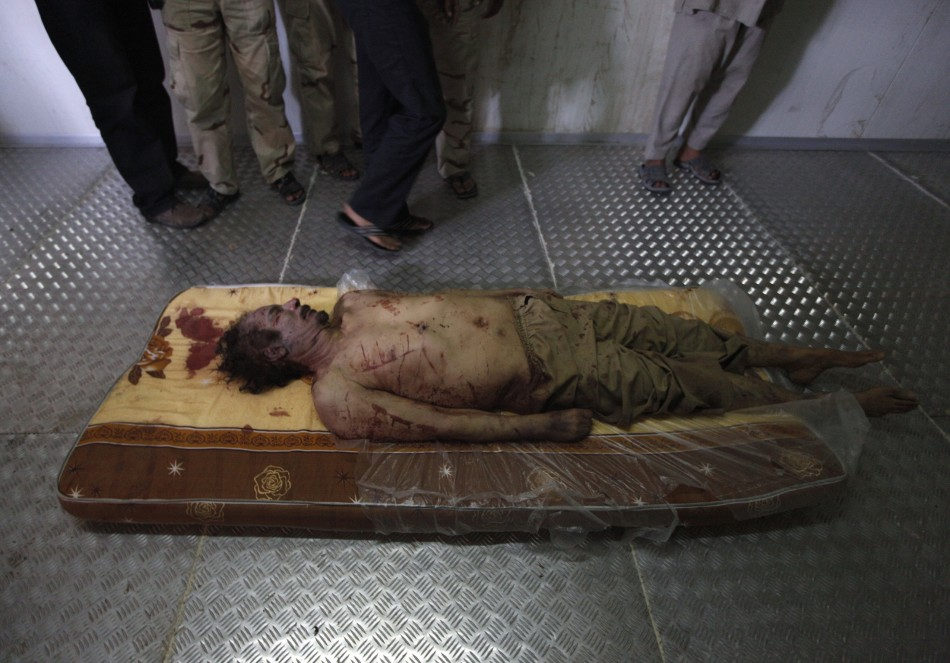 The body of slain Libyan leader Muammar Gaddafi is seen inside a storage freezer in Misrata