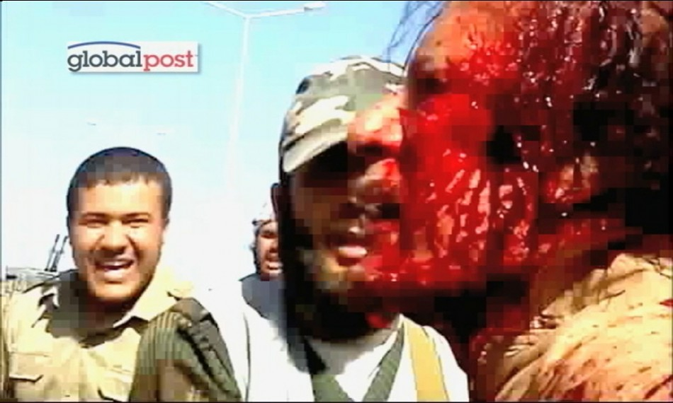 Frame grab shows former Libyan leader Muammar Gaddafi after his capture by NTC fighters in Sirte.