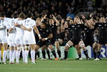 France players look on as New Zealand All Blacks' Kahui perform the Haka before their Rugby World Cup final match at Eden Park in Auckland.