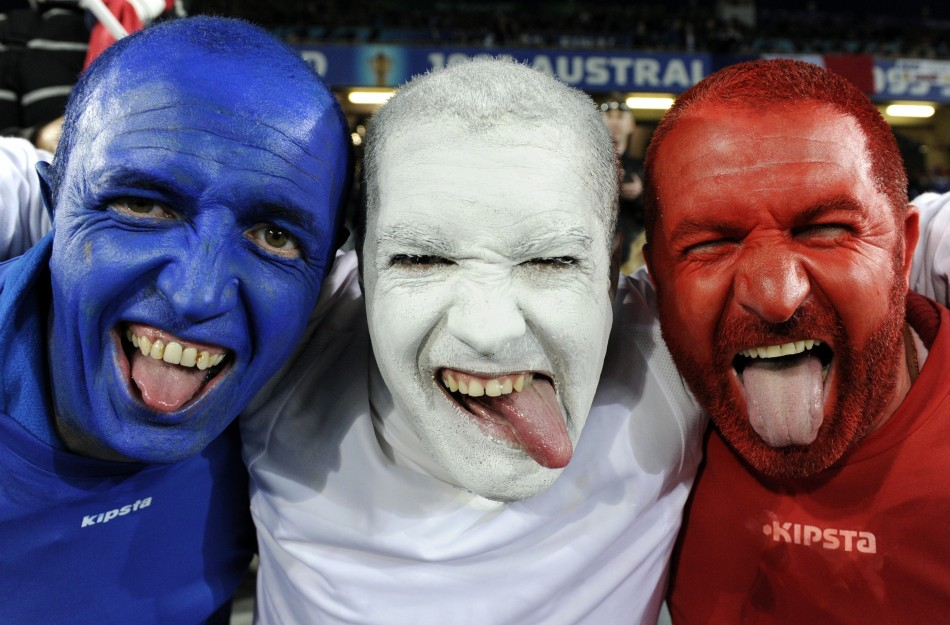 France supporters pose for a photo before the start of their Rugby World Cup final match against New Zealand All Blacks at Eden Park in Auckland.