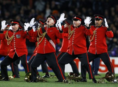 The New Zealand Army Band performs the Haka before the Rugby World Cup final match between New Zealand All Blacks and France at Eden Park in Auckland.