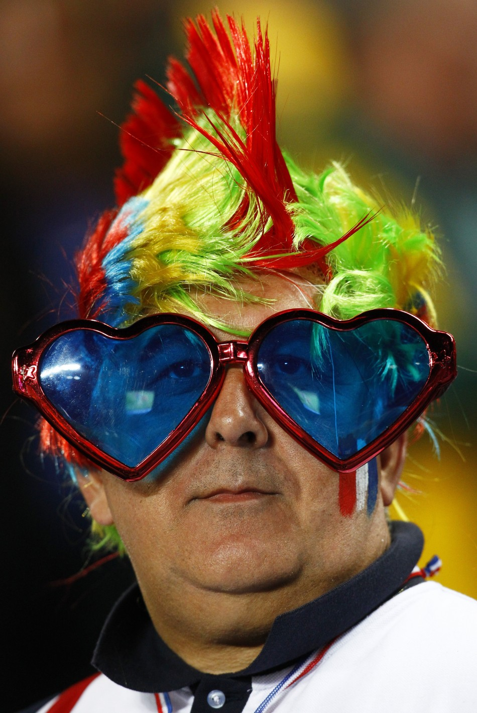 A France supporter waits for the start of their Rugby World Cup final match against New Zealand All Blacks at Eden Park in Auckland.