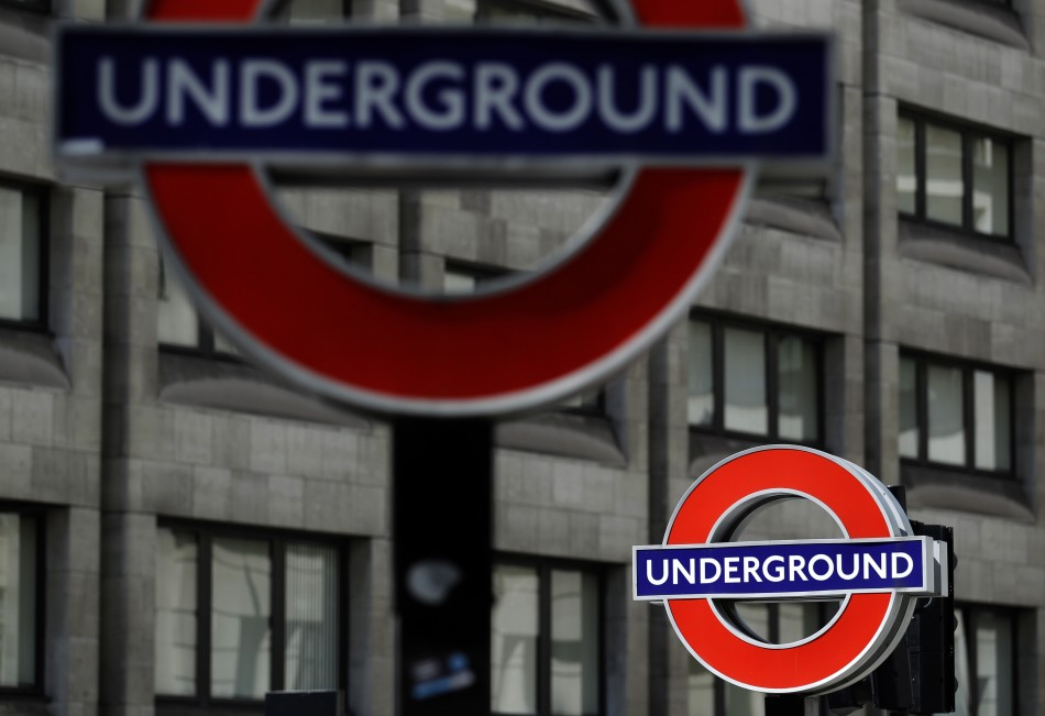 Signs for the London underground tube system are pictured in London