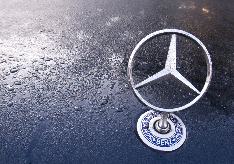 A Mercedes emblem is pictured on the bonnet of an S series car in Berlin
