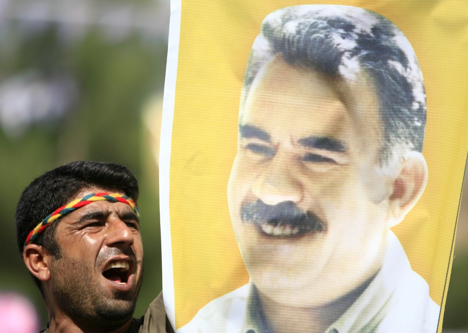 Kurdish man displays picture of PKK leader Abdullah Ocalan during