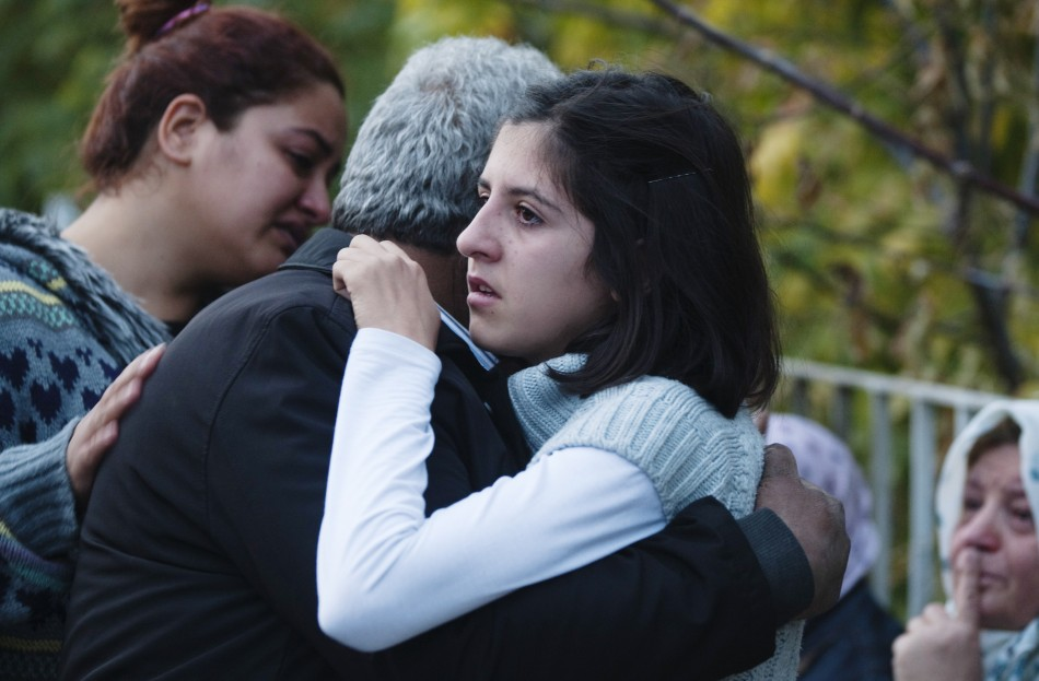 Relatives of victims of an earthquake embrace each other in Ercis on Monday.