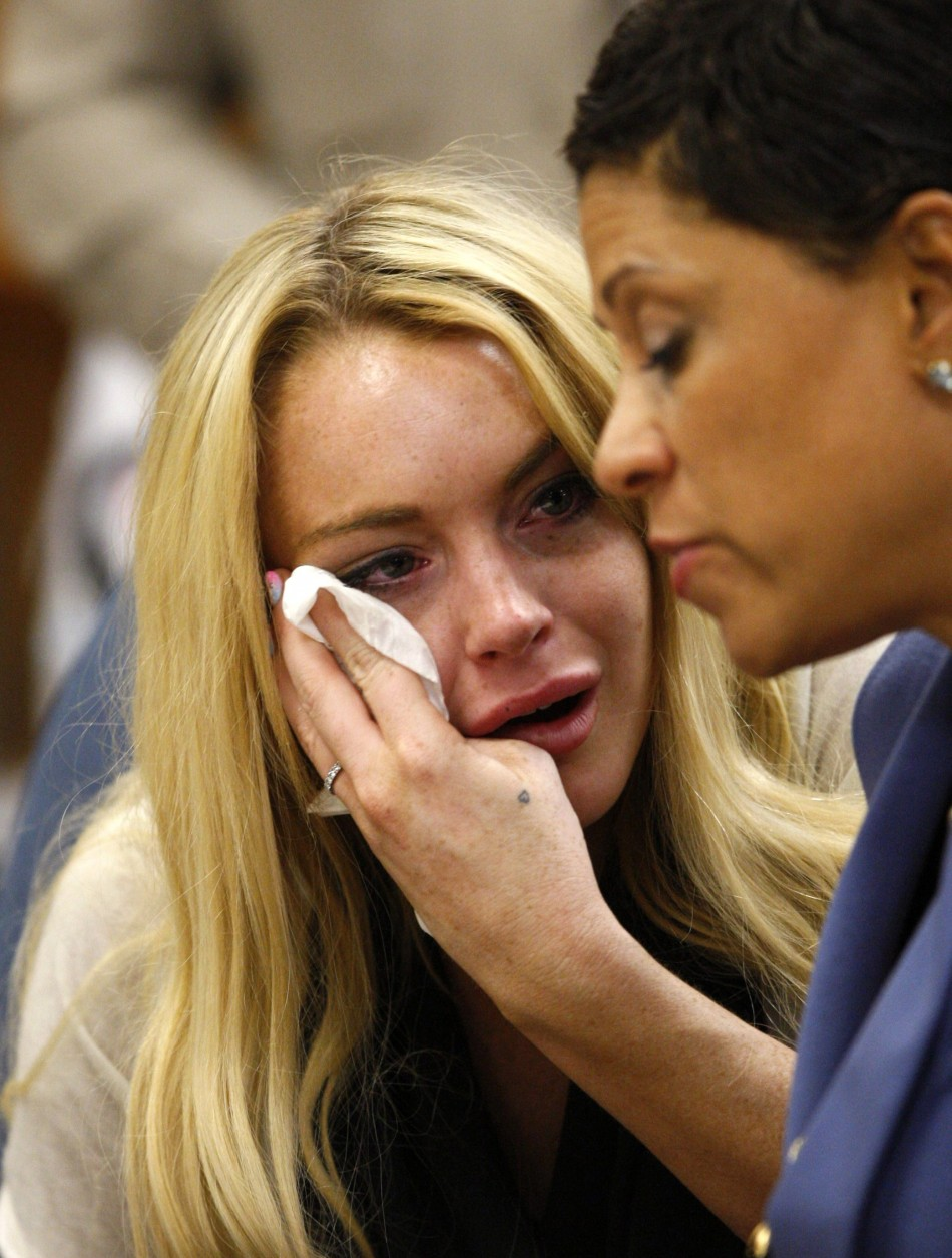 Lindsay Lohan reacts beside her attorney Shawn Chapman Holley as Judge Marsha Revel rules that Lohan had violated her probation on a 2007 drunken driving charge in Beverly Hill