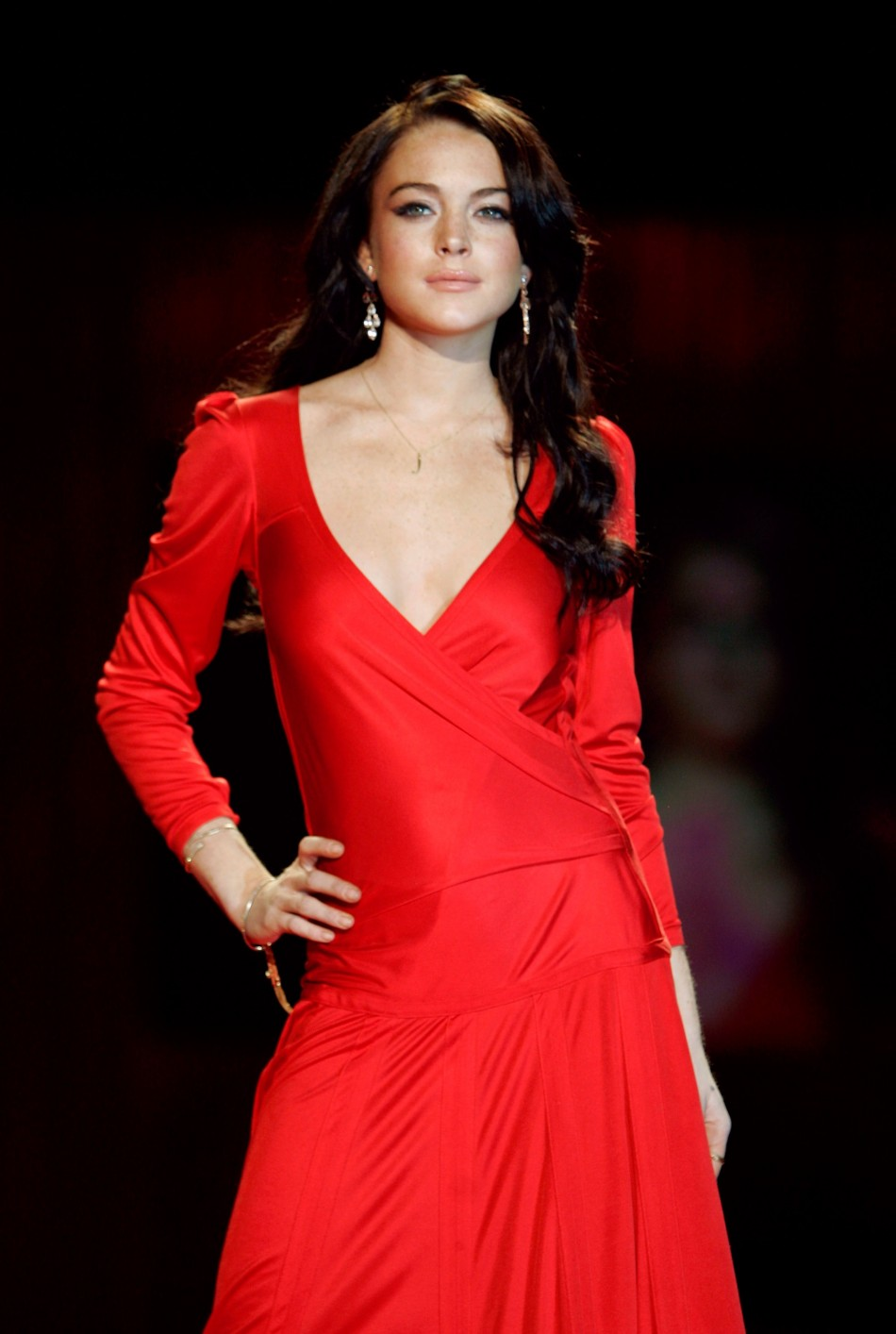 Lindsay Lohan poses in a Calvin Klein dress during the Heart Truth Red Dress fashion show at New York Fashion Week