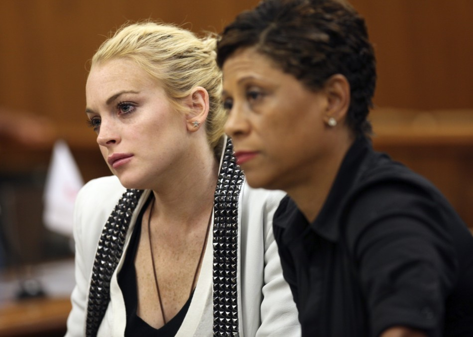Lindsay Lohan and her lawyer Shawn Chapman Holley attend a progress report hearing
