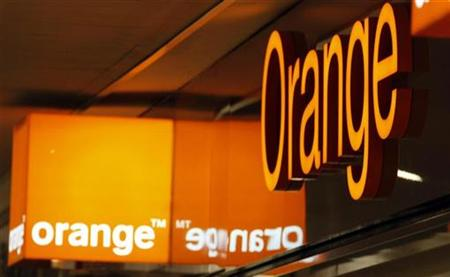 Logos of Orange are seen in front of an Orange France Telecom shop in Nice