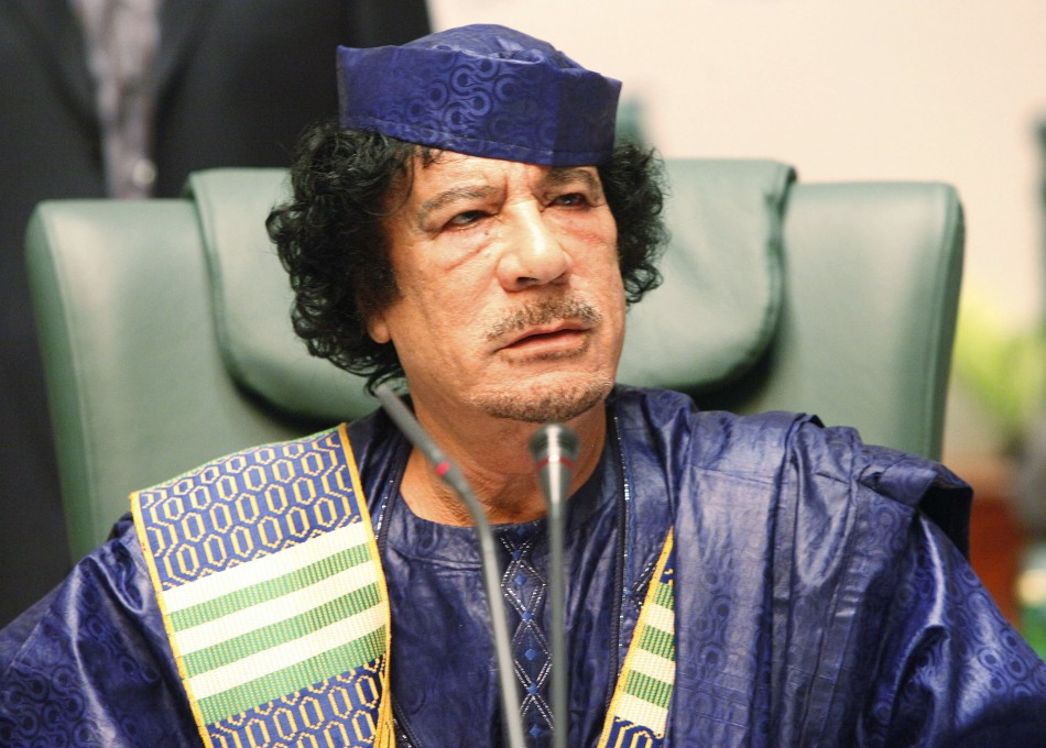 Libyan leader Muammar al-Gaddafi attends the closing session of the Arab League summit in Sirte