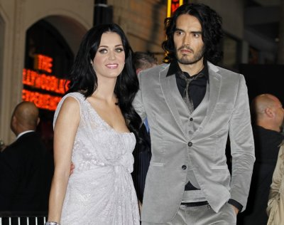 Actor Russell Brand and wife, singer Katy Perry arrive at the premiere of Brands The Tempest in Hollywood