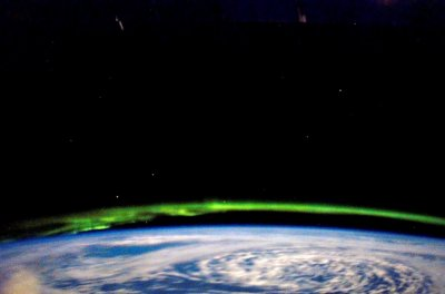While docked and onboard the International Space Station, a STS-123 Endeavour crew member captures the glowing green beauty of the Aurora Borealis on March 21, 2008.