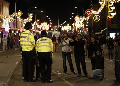 Children are photographed with British police officers during the Diwali celebrations in Leicester, central England on October 16, 2011. Diwali celebrations in Leicester are one of the biggest outside of India, with up to 35,000 people attending the switc