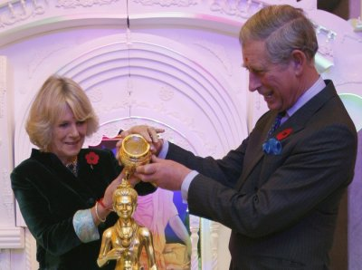 Britain039s Prince Charles and Camilla, Duchess of Cornwall left, pour holy water over the figure of a deity during their visit to the Shri Swaminarayan temple in northwest London on November 9, 2007. Britain039s Prince Charles and Camilla, Duches
