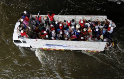 People are evacuated on a truck from a flooded area in Bangkok