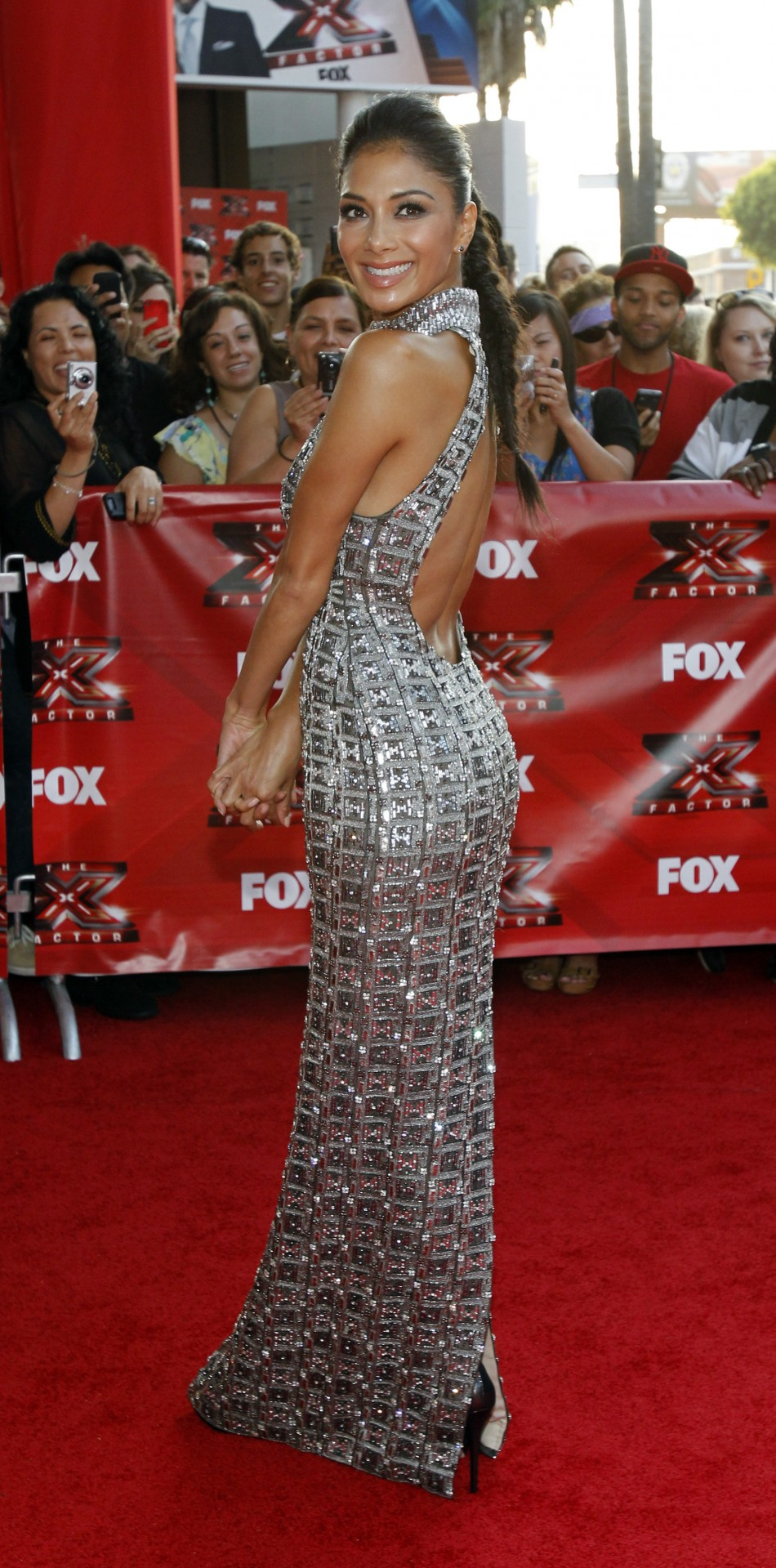 Nicole Scherzinger poses at the world premiere of quotThe X Factorquot in Hollywood