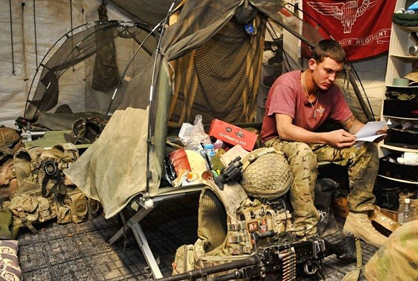 This photo of a soldier from 3rd Battalion, The Parachute Regiment, sitting in his bed
