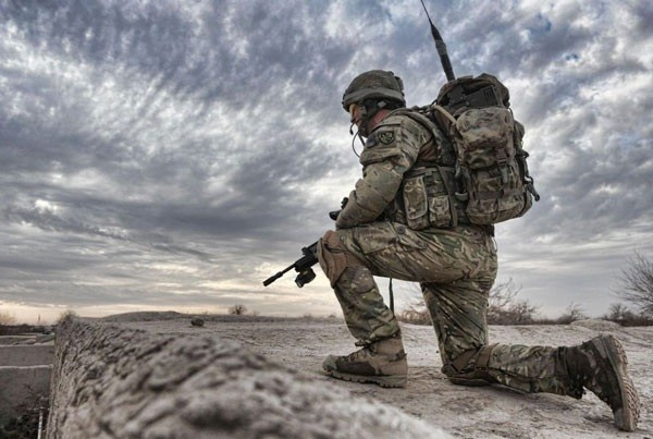A soldier from 2nd Battalion The Parachute Regiment 2 PARA, observes from a compound roof near the town of Char Coucha, Afghanistan