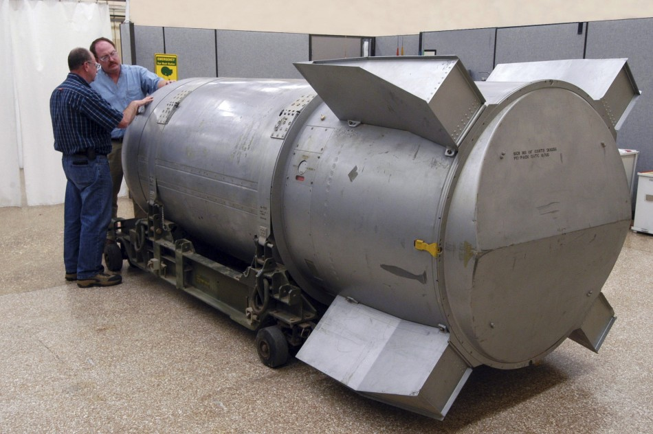 Workers examine a B53 nuclear bomb at B&W Pantex nuclear weapons storage facility outside Amarillo